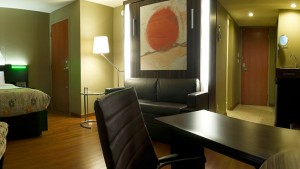 Hospitality room with queen bed, murphy bed and no window
