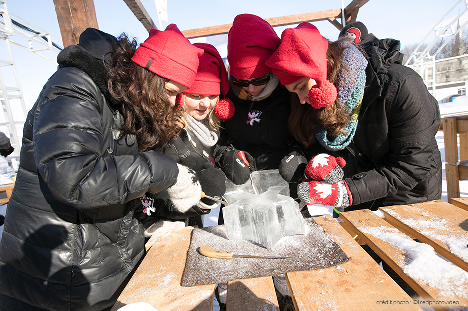Group participating in an ice sculpture workshop at Quebec Winter Carnival