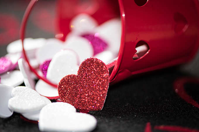 Red bucket spilling hearts for Valentine's Day