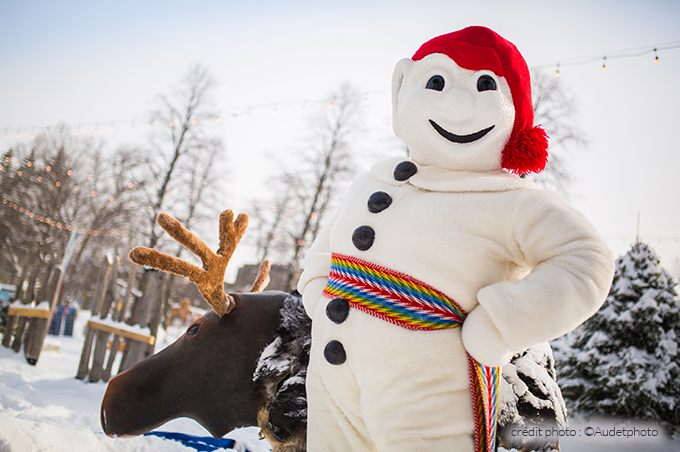 Bonhomme and a moose at Quebec Winter Carnival